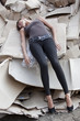 unconscious woman lying in cartons
