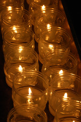 Church votive prayer candles in jars