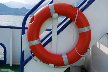 Orange lifebuoy ring on a ship