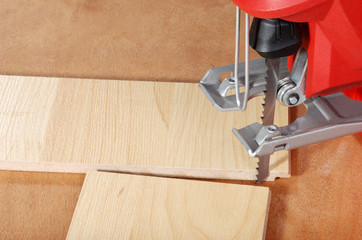 jigsaw and cut wood flooring