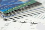 credit cards on bank invoice. very shallow DOF poster