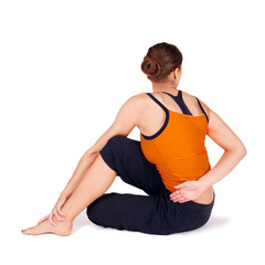 Woman Practicing Twist Pose Yoga Exercise