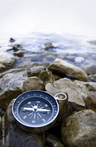 Leinwandbild Motiv compass on the shore