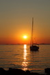 Gold romantic sunset with yacht