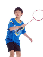 cute boy playing badminton ready to block