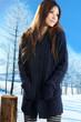 asian model posing in winter snowy park