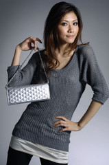photo of Fashionable young woman with hand bag