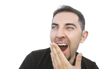Young man yawning.