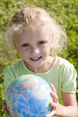 Little girl holding globe