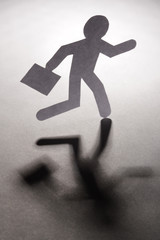 Abstract businessman running