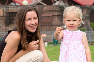 Happy young woman with little daughter