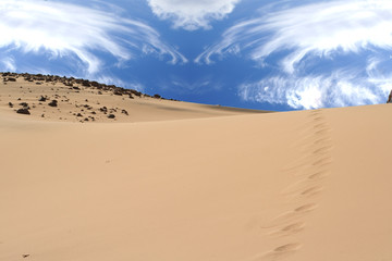 Sand background with clouds
