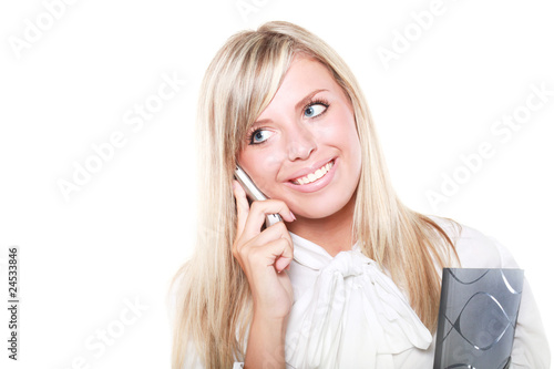 Young beautiful happy blond buisinesswoman with mobile phone