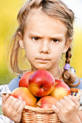Little girl with basket of apples