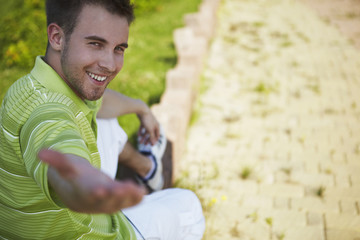 cheerful guy in a green vest.