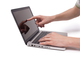 hand pointing to a laptop