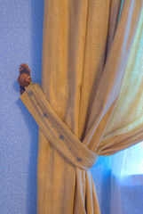 brown curtain in the wings with a blue wall