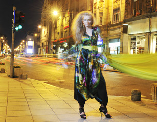 elegant woman on city street at night