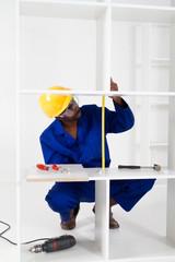 african carpenter making furniture