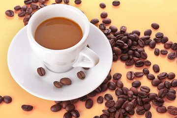 Small white cup of coffee with coffee grain