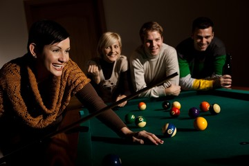 Woman laughing at snooker table