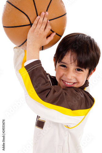 Portrait of a kid throwing ball at camera