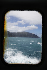 Ship window and rough sea