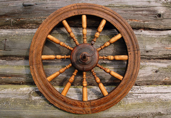 Spinning Wheel on Log House Wall
