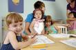 Preschool girl writes