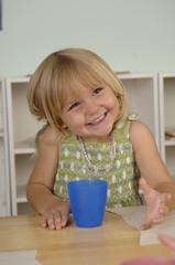 Preschool girls drinks milk