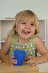 Preschool girl eating snack