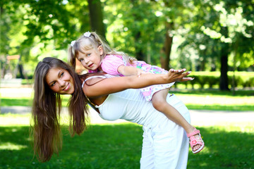 sweet and beautiful girl with mom