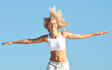 happy blond teenager running with outstretched arms