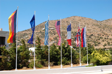 The flags at entrance of luxury hotel, Crete, Greece