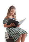 Little girl with pigtails reading a book poster