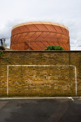 Gas holder and brick wall