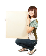 girl  holds an empty poster.