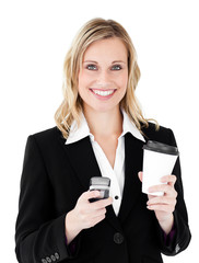 Beautiful  businesswoman holding coffee and using her cellphone