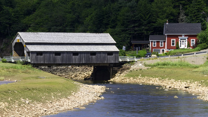 COVERED BRIDGE OVER ROCKY STREAM