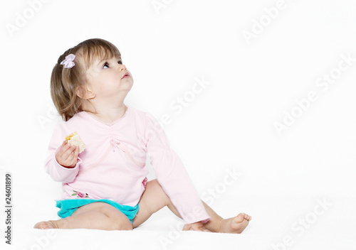 The little girl on a light background