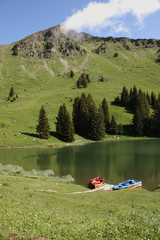 Alpine lake with boats