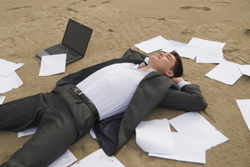 businessman relax on the beach