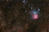 Trifid Nebulae complex among Milky Way stars in Sagittarius.