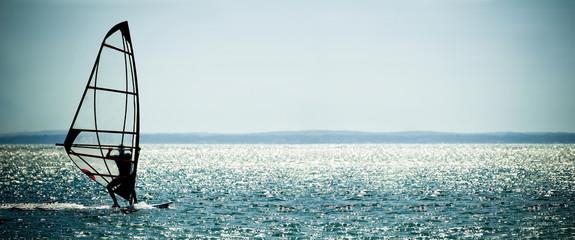 windsurfer panorama against a crystal sea