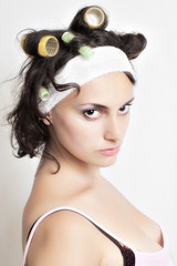 Portrait of housewife with curlers in her hair
