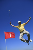 GOLF - lucky golfer is jumping in the air