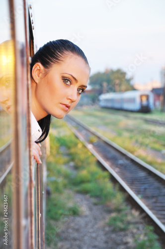 beautiful young lady looking outside the train