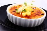Delicious french dessert creme brulee in porcelain bowl