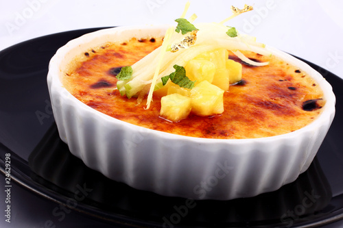 Delicious french dessert creme brulee in porcelain bowl
