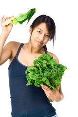 Young Asian woman with green vegetables